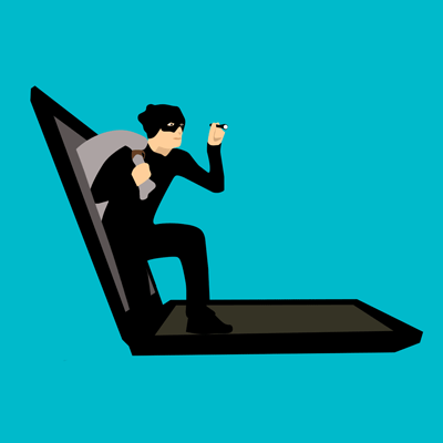 Information security image of a hacker emerging from a laptop computer